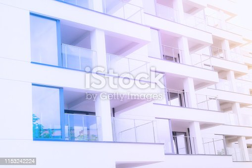 Rows of flats in modern residental building in pastel tone.