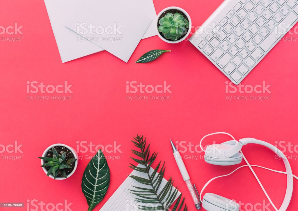 Pastel office desk table with a laptop and headphone. Top view with copy space. Flat Lay stock photo