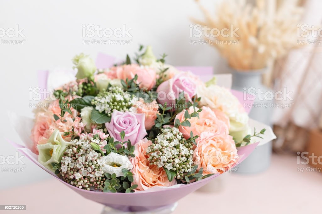 Pastel Orange And Lilac Bouquet Of Beautiful Flowers On Wooden Table ...