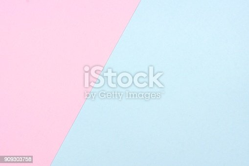 Pastel pink and blue paper texture abstract background. Off center, angle.