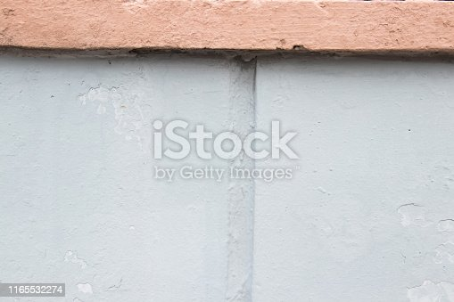 Pastel pink and pastel blue parts of the wall. Background for design. Place for text. Background for your design.