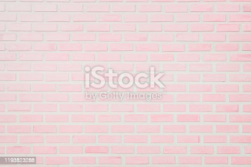 Pastel Pink and White brick wall texture background. Brickwork or stonework flooring interior rock old pattern clean concrete grid uneven bricks design stack.