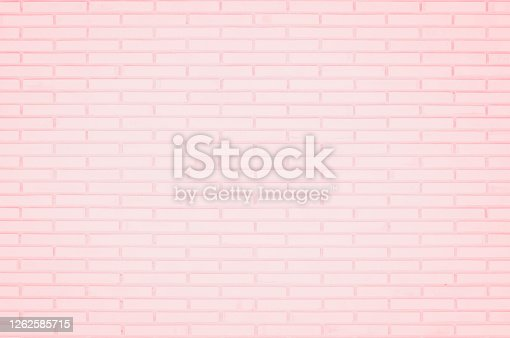 Pastel Pink and White brick wall texture background. Brickwork or stonework flooring interior rock old pattern clean concrete grid uneven brick design stack. Home or office design backdrop decoration.