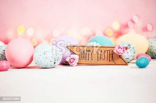 istock Pastel pink background with message and pastel eggs for Easter 930552888