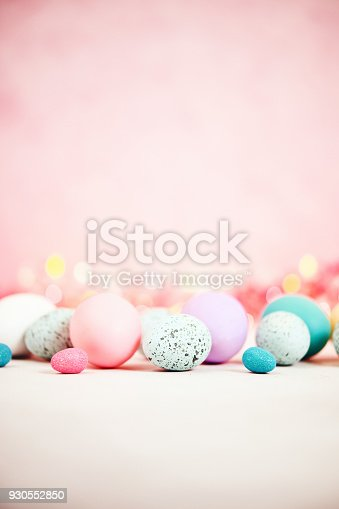 istock Pastel pink background with pastel eggs for Easter 930552850