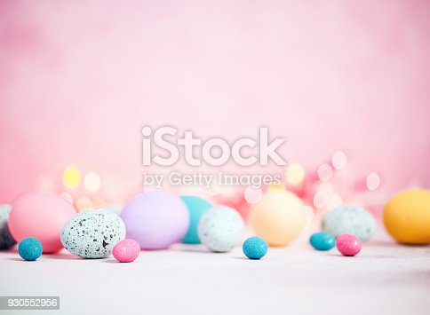 istock Pastel pink background with pastel eggs for Easter 930552956