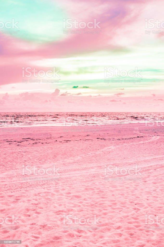 Brilliant pink tropical beach. Vertical.