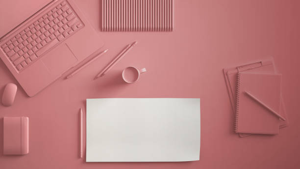 Pastel pink monochrome minimal office table desk. Workspace with laptop, notebook, pencils and coffee cup. Flat lay, top view, blank paper mockup template - foto stock