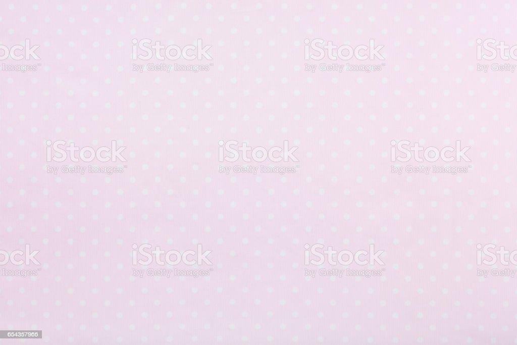 Pastel pink polka dot fabric background stock photo
