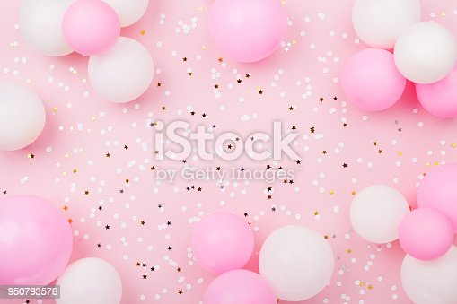 istock Pastel pink table with frame from balloons and confetti for birthday top view. Flat lay. 950793576