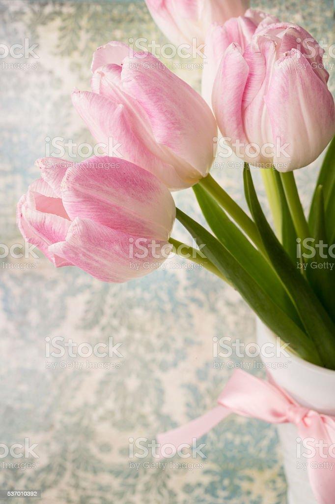 Pastel Pink Tulips In White Vase stock photo