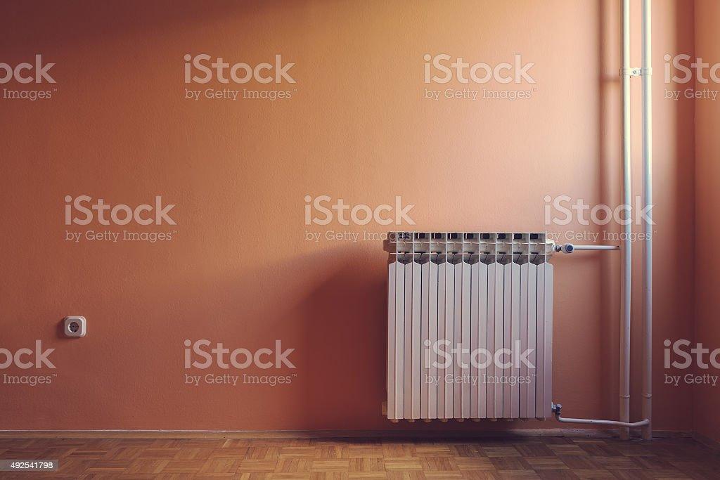 Pastel retro color of windows illuminated empty room with radiator stock photo