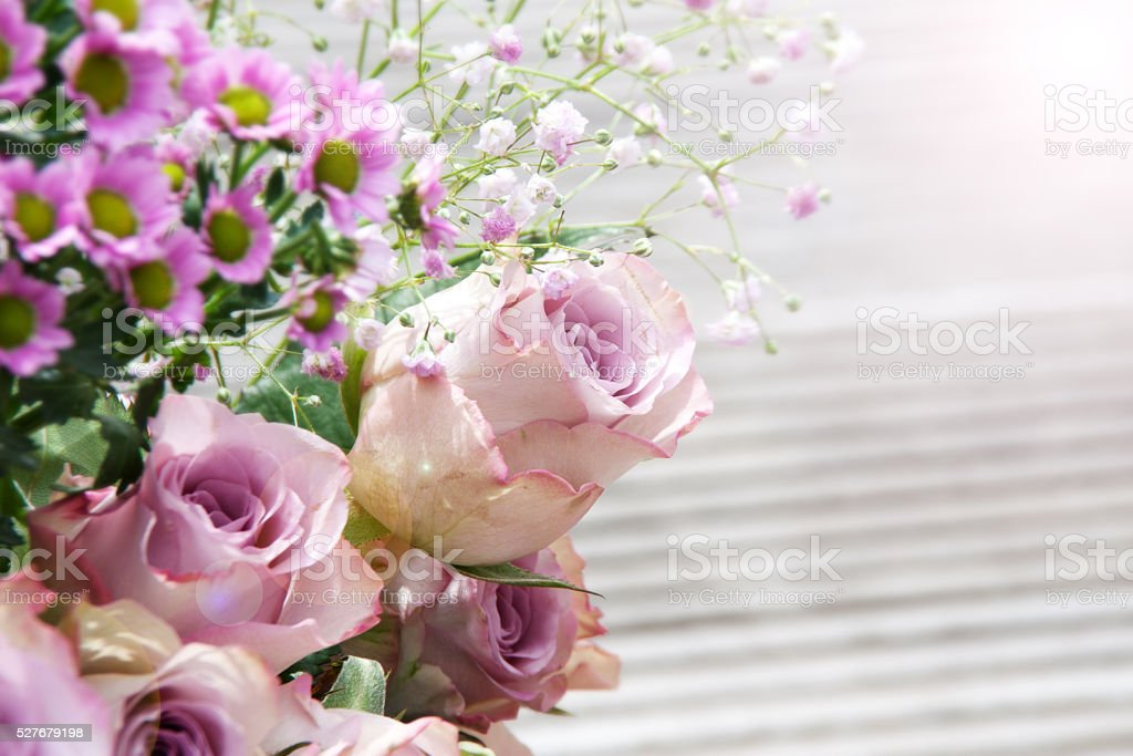 Pastel rose in a bouquet of flowers stock photo