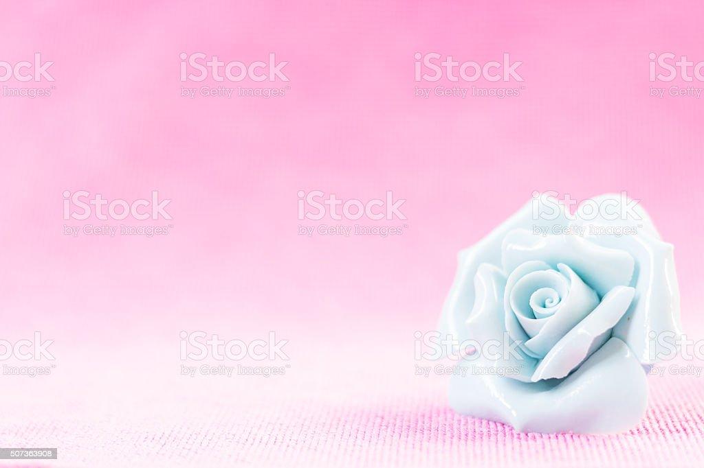 Pastel Rose on pink fabic background
