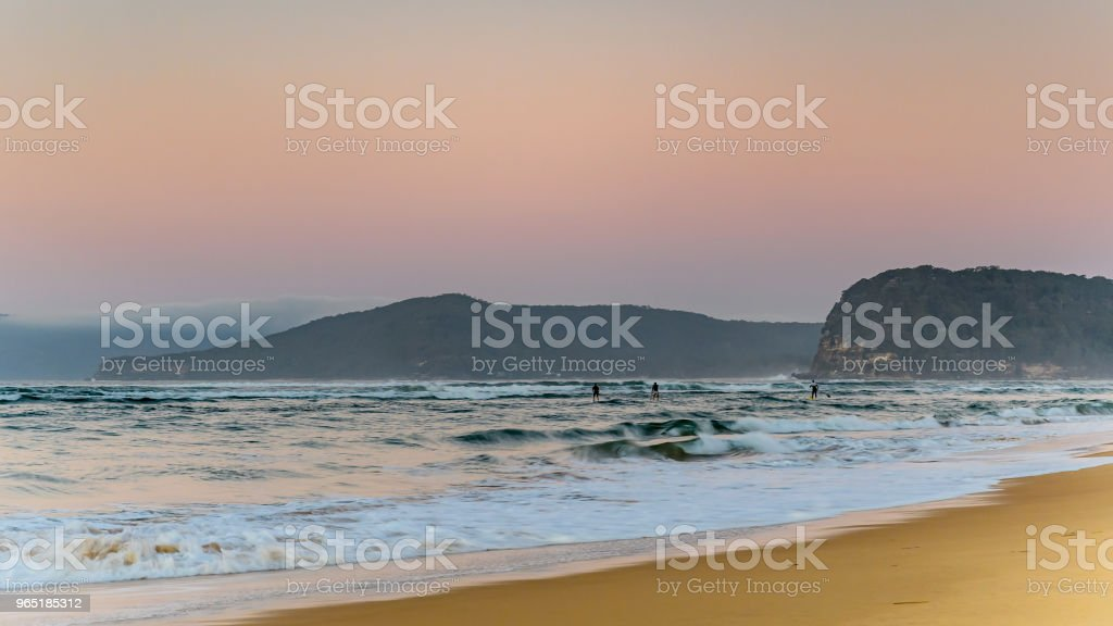 Pastel Seascape with Paddleboarders royalty-free stock photo