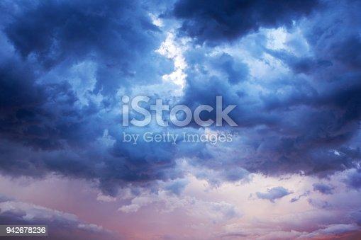 516351793 istock photo Pastel Storm Clouds Split 942678236