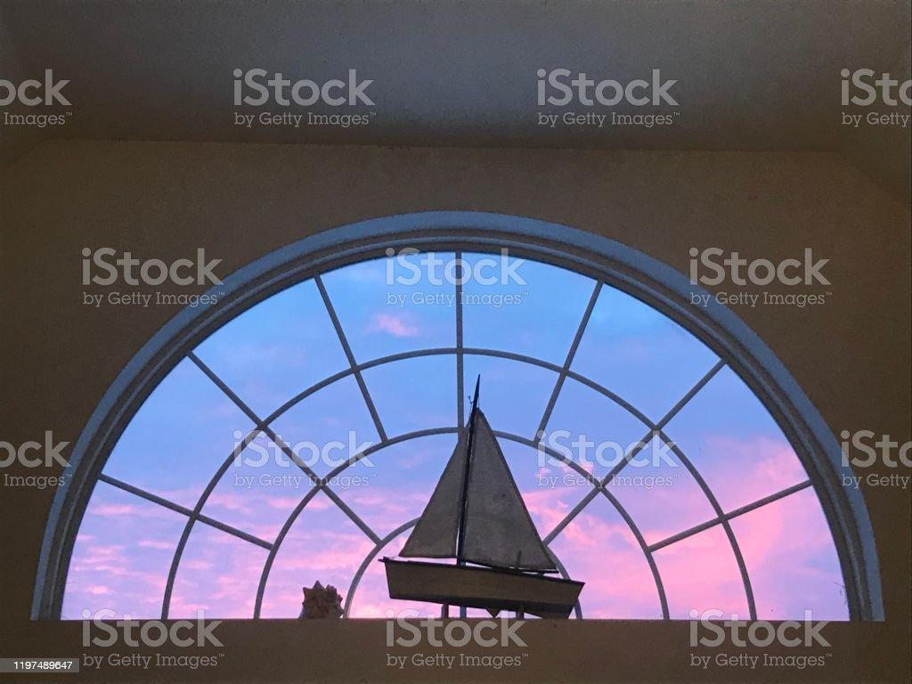Pastel Sunset Through A Half Moon Window Stock Photo Download Image Now Istock