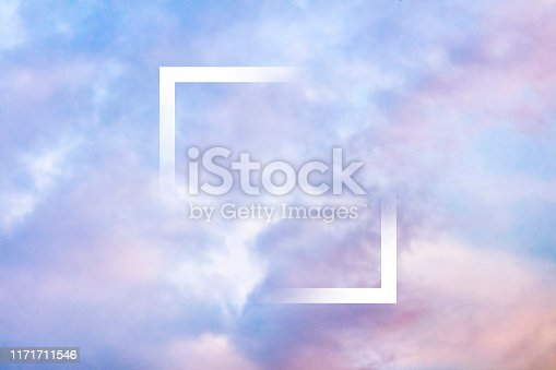 646012098istockphoto Pastel toned purple sky background with clouds and a frame, an abstract design template with a place for text 1171711546