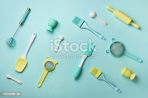 istock Pastel yellow, blue cooking utensils on turquoise background. Food ingredients. Cooking cakes and baking bread concept. Copy space. Top view. Flat lay 1003098100