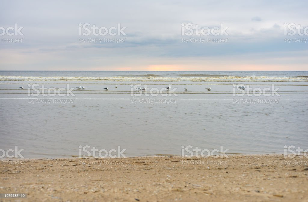 Pastel-colored sunset over a beach at the North Sea stock photo