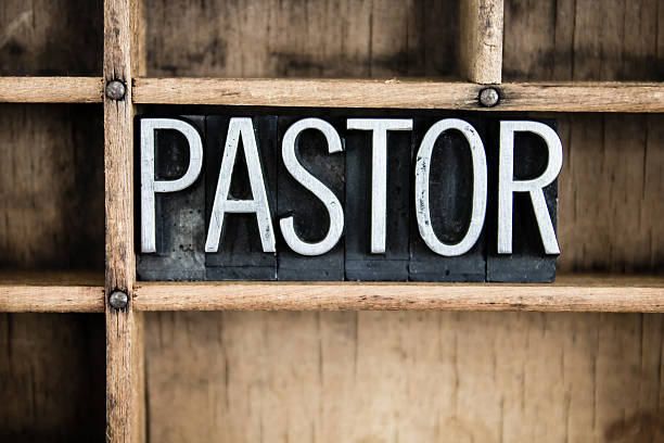 pastor concept metal letterpress word in drawer - preacher stock photos and pictures