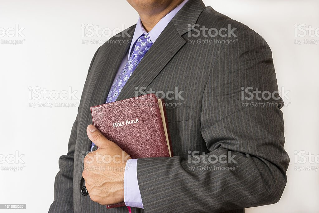 Pastor Holding the Bible royalty-free stock photo