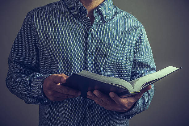 Pastor or preacher with the Bible on his hands stock photo
