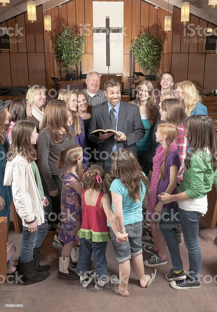 Pastor with His People Around Him royalty-free stock photo