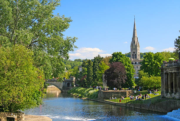 Pastoral scene in Bath, England on the River Avon Pastoral scene in Bath, England on the River Avon on a sunny day with blue sky bath england stock pictures, royalty-free photos & images
