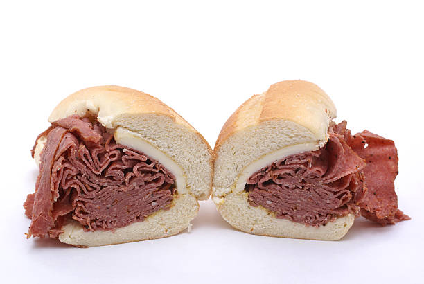 pastrami and cheese sandwich cut - pastrami stock pictures, royalty-free photos & images