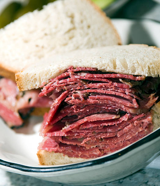 pastrami corned beef combo sandwich - pastrami stock pictures, royalty-free photos & images