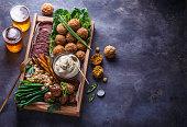 istock Pastrami, falafel, babagahanoush, veggies and beer in a wooden box, copyspace. 1179124887