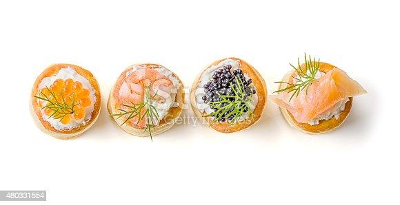 Pastries with salmon, caviar and shrimp