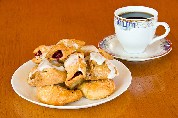Pastry and a cup of coffee on wooden table