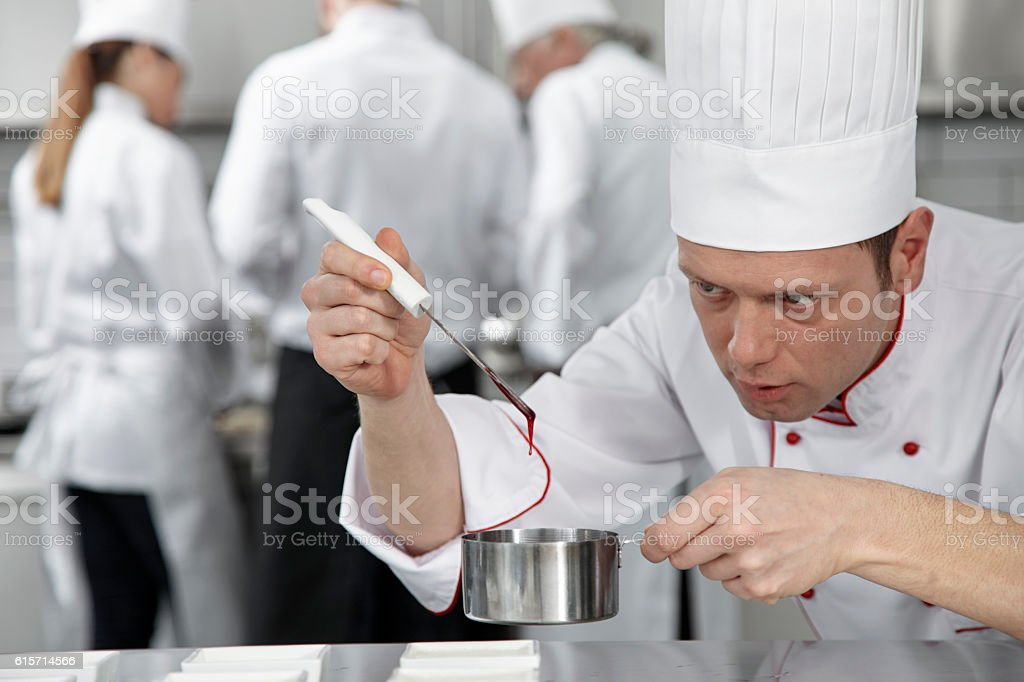 Pastry chef decorating desserts stock photo