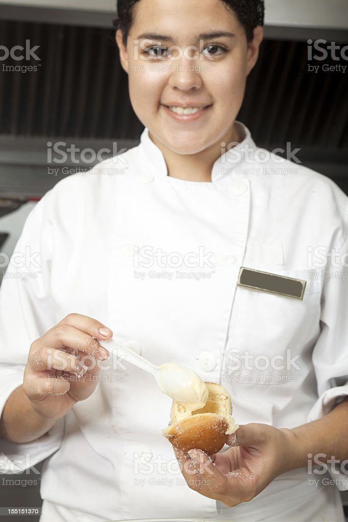 Pastry Chef filling Donuts royalty-free stock photo