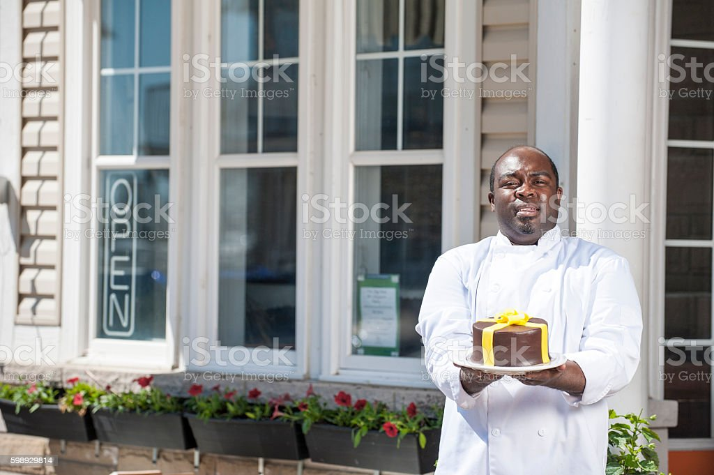 Pastry Chef Holding His Cake stock photo