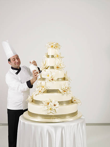 pastry chef on duty - big cake stock photos and pictures