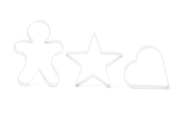 Pastry cutters isolated on white. Star, heart, stick man shape. Pastry cutters isolated on white. Star, heart, stick man shape. cookie cutter stock pictures, royalty-free photos & images