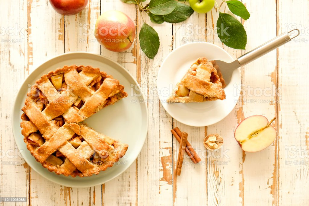 Traditional American Thanks Giving pie, whole & halved apples,...