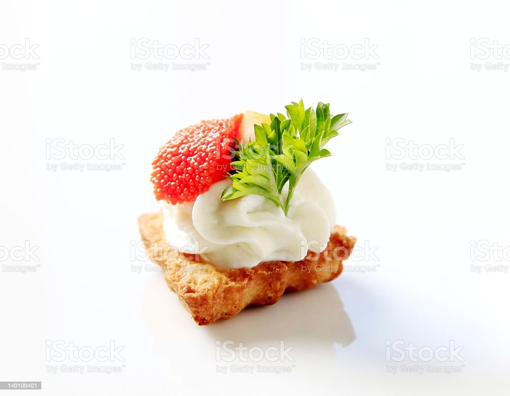 Pastry topped with savory spread and caviar royalty-free stock photo