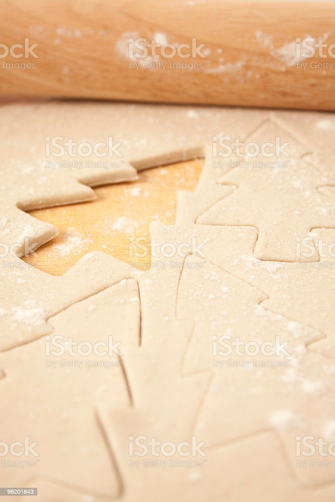 Pastry with Christmas Tree Shapes and Rolling Pin royalty-free stock photo