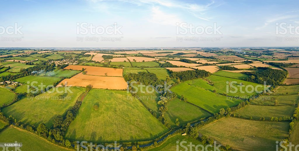 Pasture patchwork, farms and fields stock photo