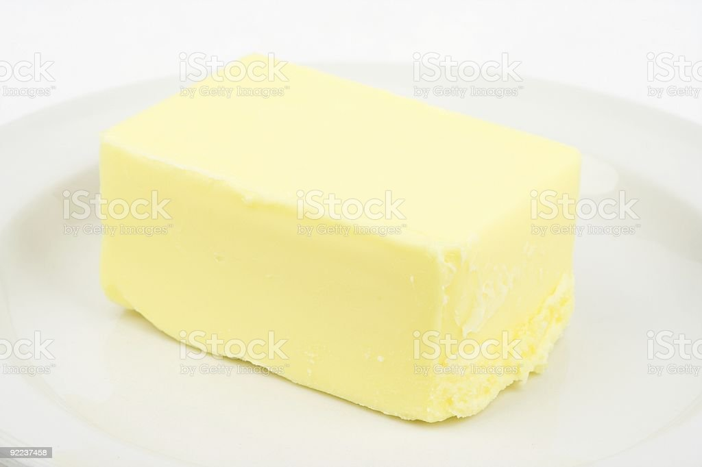 Pat Of Butter On Plate royalty-free stock photo