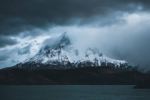 Patagonia snow capped mountains in a stormy atmosphere stock photo