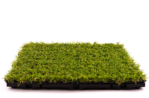 Patch of Artificial Turf Tile of an artificial turf isolated on white background in high quality definition. Nikon D7000, Nikkor 16-85mm. Studio indoor shot. turf stock pictures, royalty-free photos & images