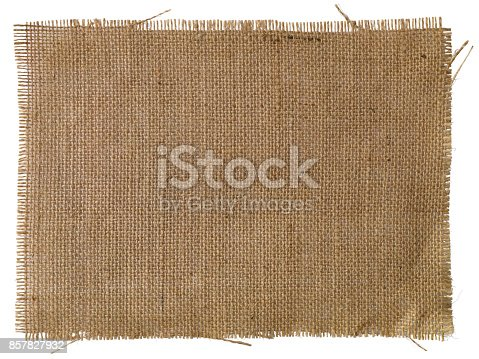A patch of natural burlap fabric background, isolated on white, clipping path included.