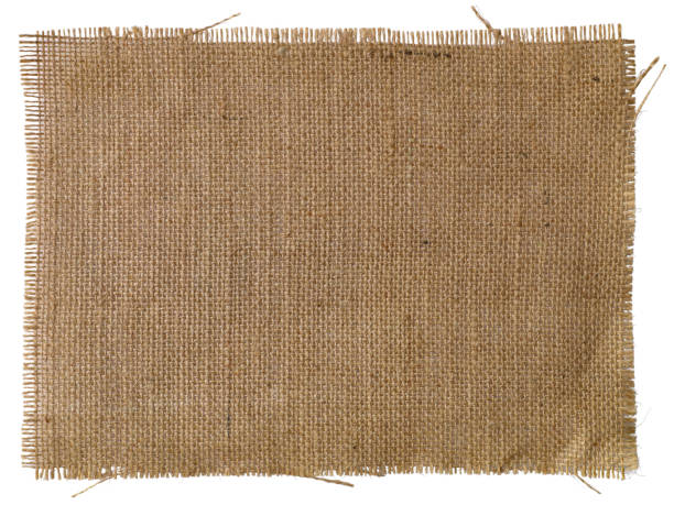 patch of natural burlap fabric background. - pezze di stoffa foto e immagini stock
