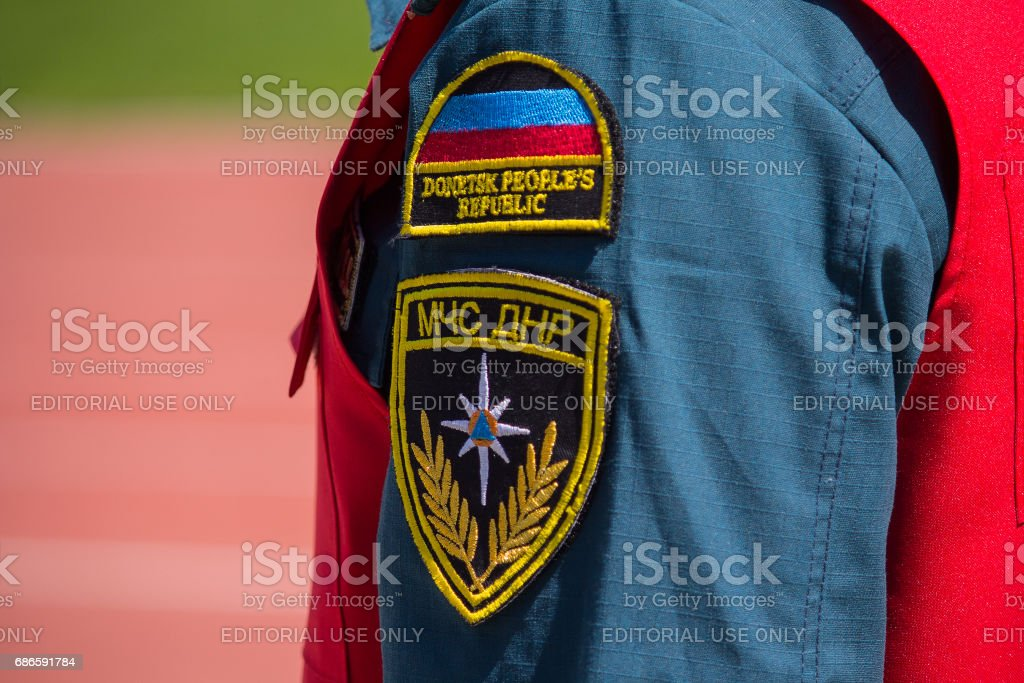 Patch of the Ministry of Emergency Officer on the sleeve stock photo