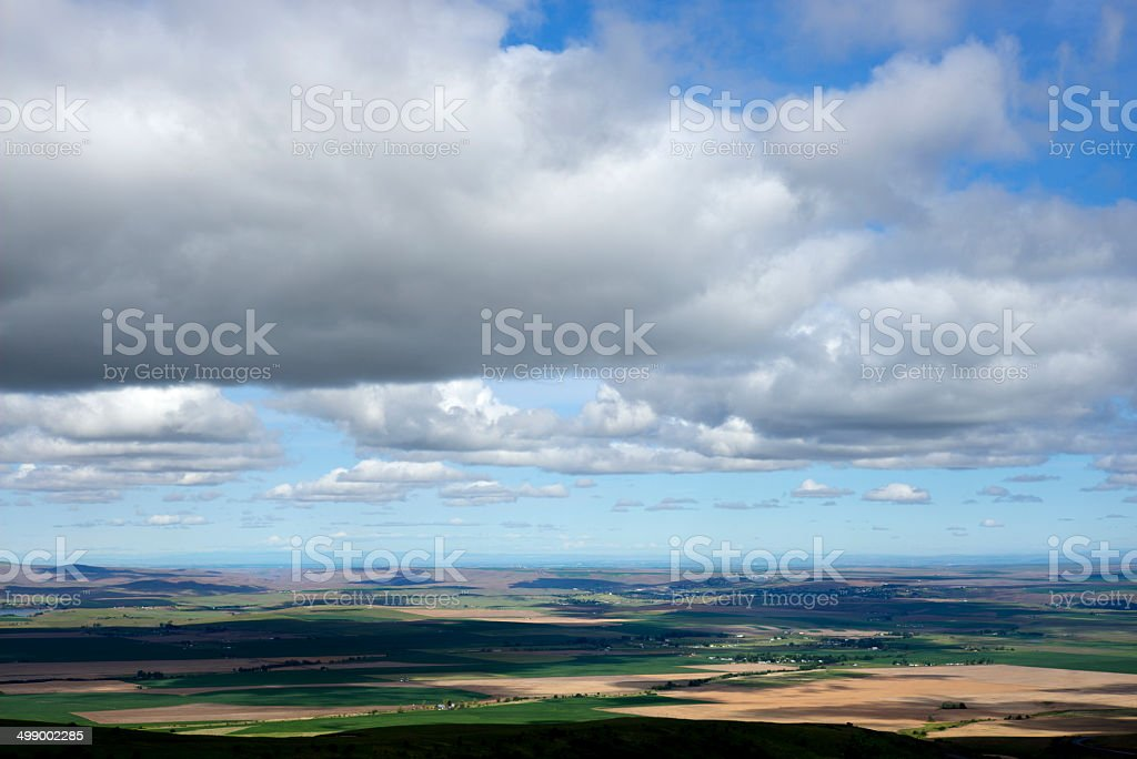 Patchwork farmland under scattered clouds royalty-free stock photo